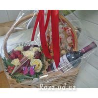 Basket with flowers and sweets - Photo 1